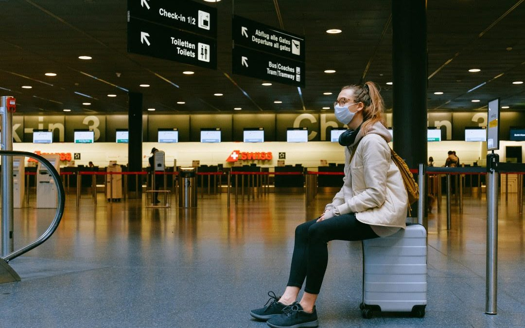 Woman Waiting At Airport