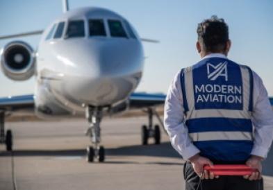 Modern Aviation Fbo Denver Employee And Plane